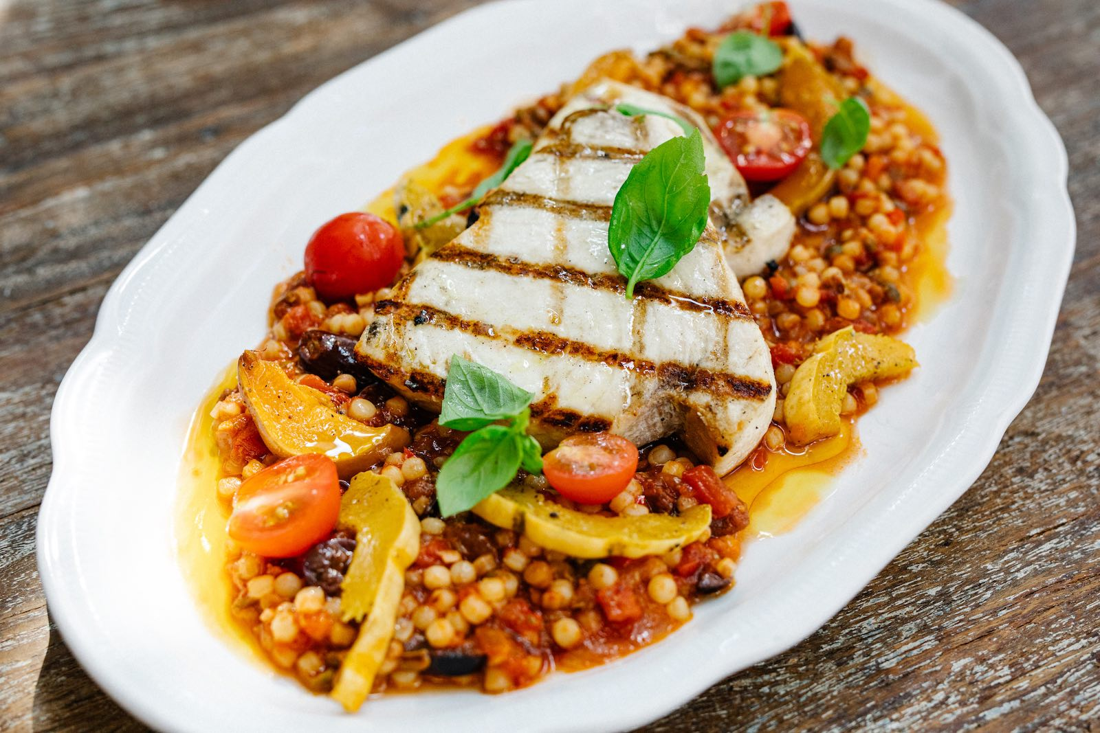 The pesce alla puttanesca at Osteria Georgi pairs Sardinian couscous with the fish of the day
