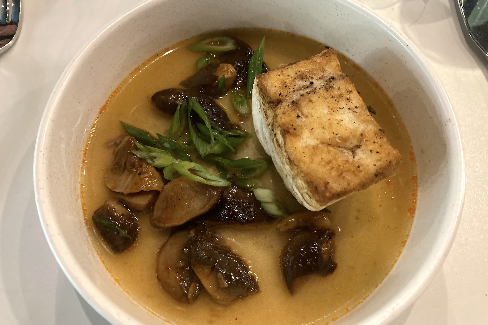 Halibut with miso dashi and dark spore mushrooms, a most American dish from CAMP in Greenville
