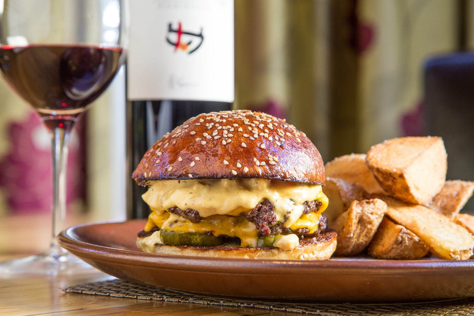 The Husk cheeseburger with potato wedges clocks in at $17 on the 2021 Burger Index