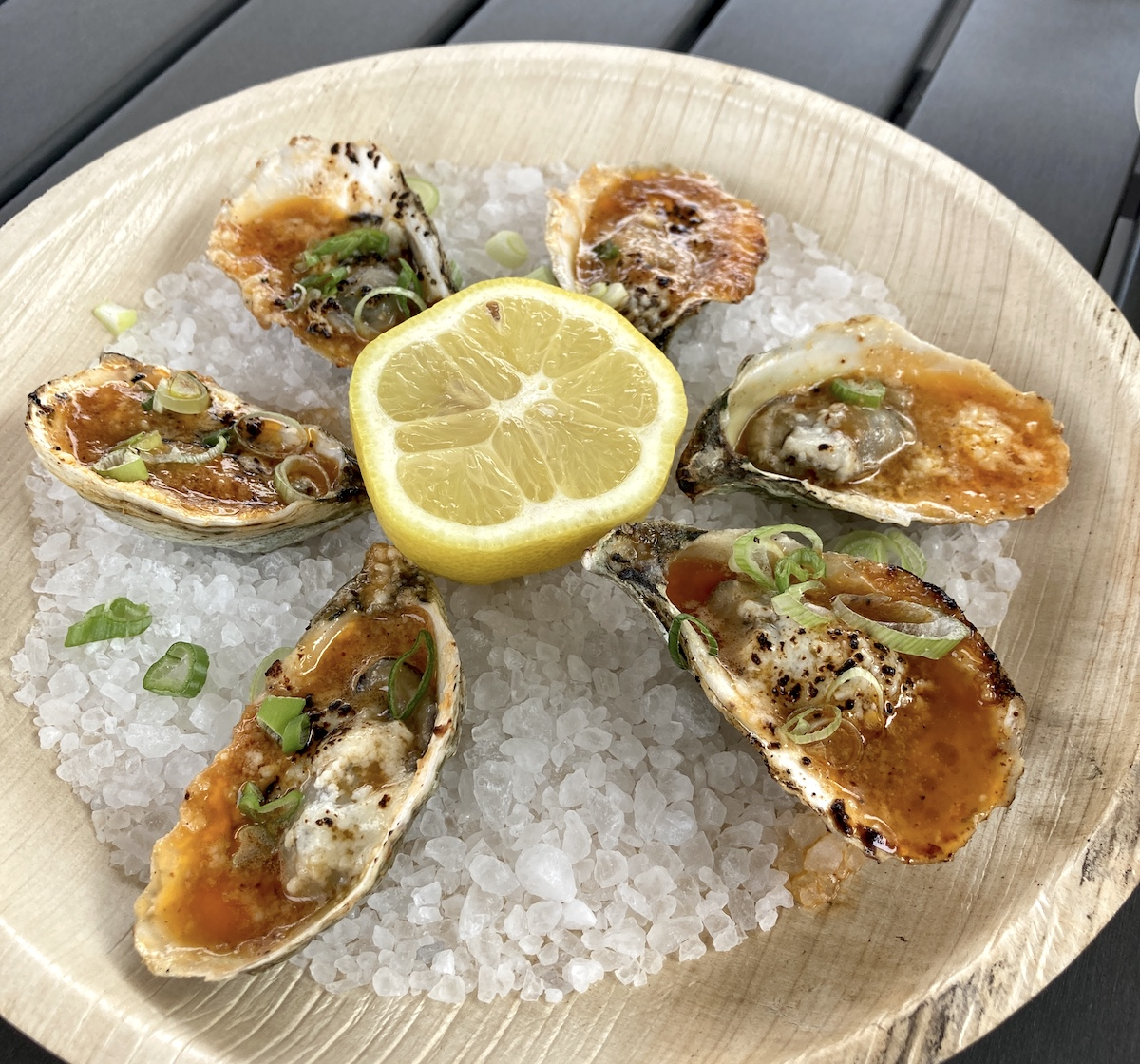 Grilled BBQ oysters with cotija cheese at Lawrence Barbecue