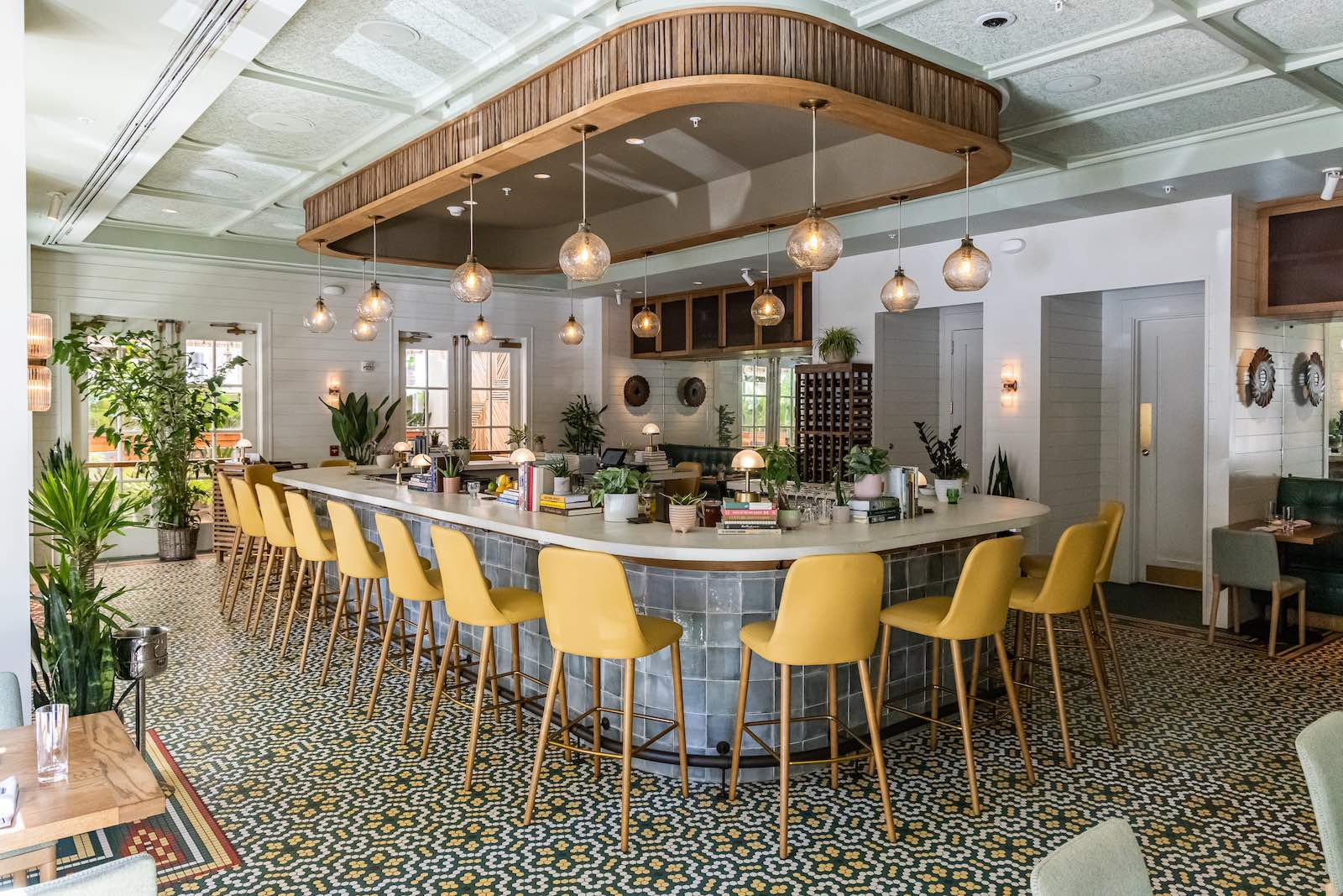 The dining room at Lenoir, built around the big white-topped bar, brings a fresh new perspective to Lowcountry dining
