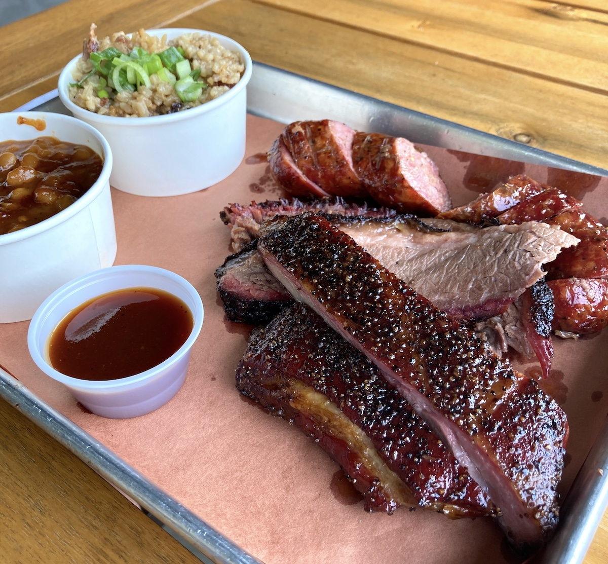 The Texas Trinity of brisket, ribs, and sausage plus the phenomenal barbecue rice at Prime BBQ in Knightdale