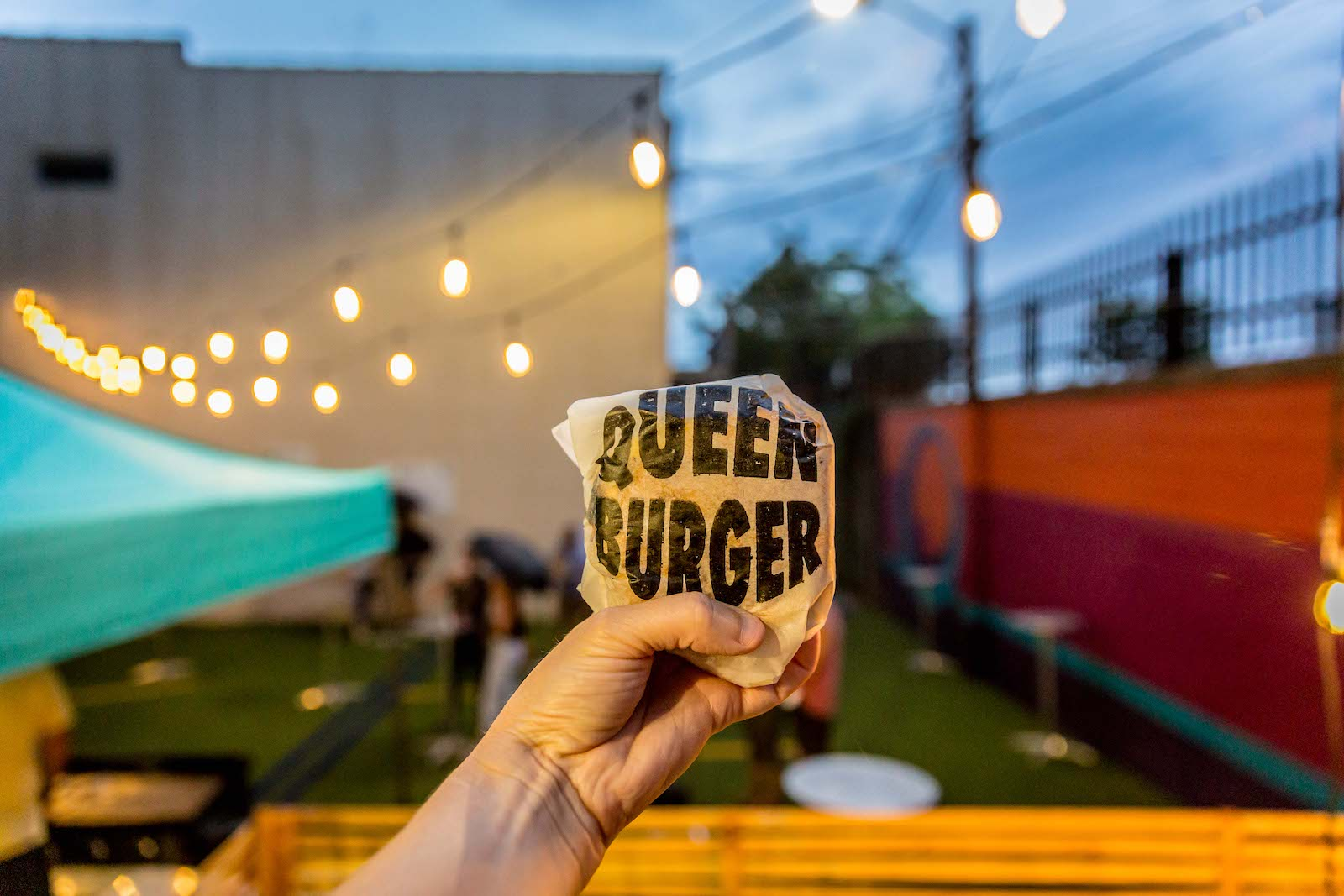 QueenBurger rolled up the Astroturf in August but now it's coming back to a permanent home