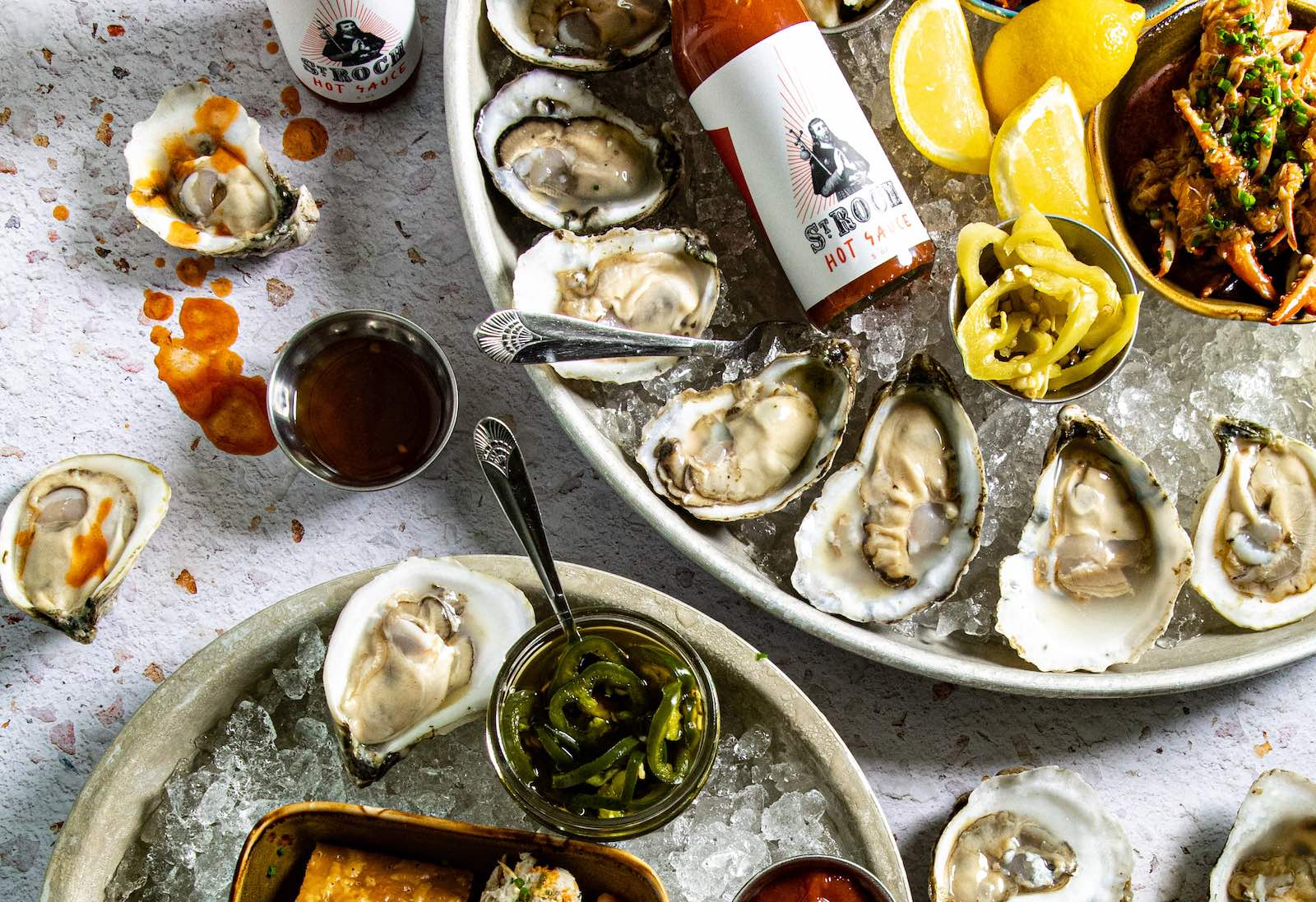 Fresh shucked oysters and New Orleans-inspired favorites are back at the fully renovated St. Roch Fine Oysters + Bar in Raleigh